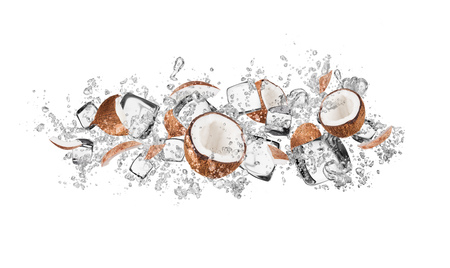 Pieces of coconuts in water splash and ice cubes, isolated on white background Stock Photo