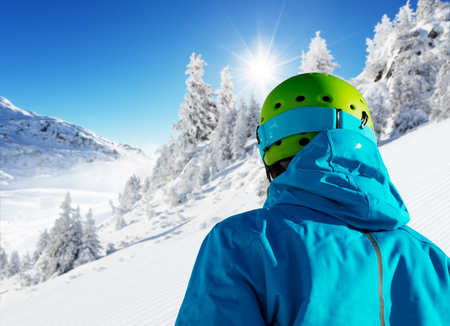 off piste: Backside view of skier looking at beautiful winter landscape