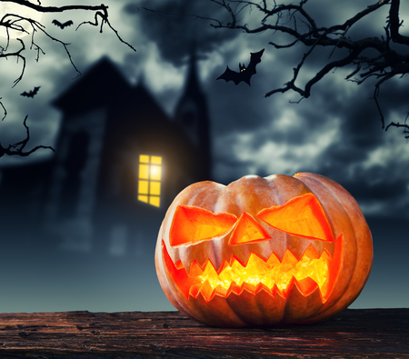Scary halloween pumpkin with horror background. Empty space for text