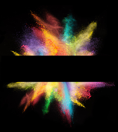 Explosion of colored powder with empty space for text, isolated on black background