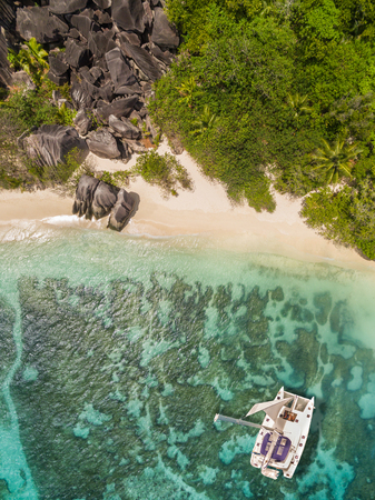anse source d argent: Aerial photo of Seychelles tropical beach Anse Source D Argent at La Digue island with catamaran boat
