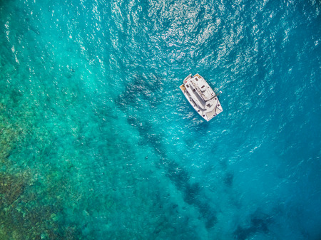 Aerial view of catamaran sailling in ocean open water