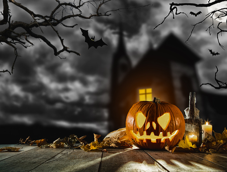 copysapce: Scary halloween pumpkin with horror background. Empty space for text
