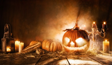 copysapce: Scary halloween pumpkin on wooden planks. Empty space for text