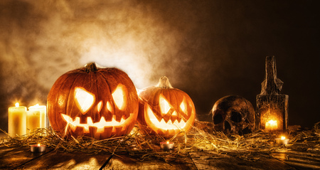 copysapce: Scary halloween pumpkins on wooden planks. Empty space for text Stock Photo