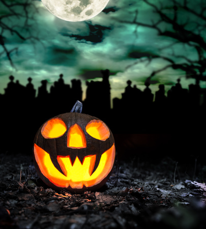 scary halloween: Scary halloween pumpkin with graveyard background. Empty space for text Stock Photo