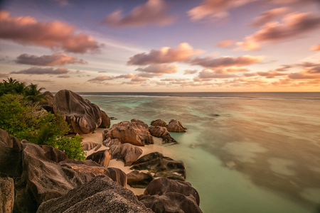 argent: Beautiful Seychelles tropical beach Anse Source D Argent at La Digue island in sunset Stock Photo