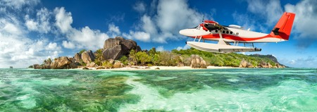 anse source d argent: Beautiful Seychelles tropical beach Anse Source D Argent at La Digue island with flying seaplane