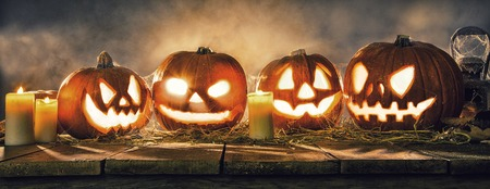 Scary halloween pumpkins on wooden planks. Empty space for text Stock Photo