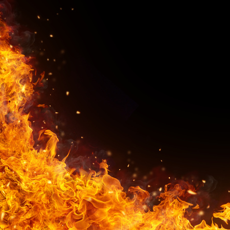 Abstract fire flames background with free space for text. Isolated on black
