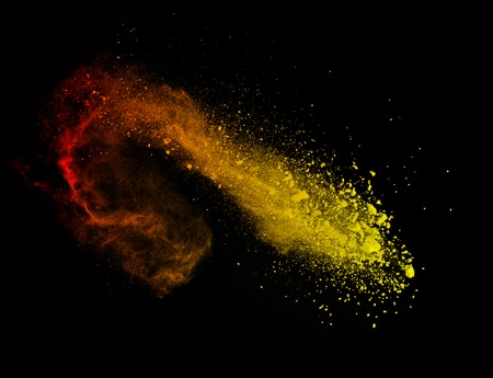 Explosion of colored powder, isolated on black background Stok Fotoğraf