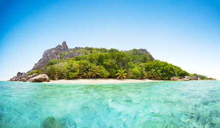 panoramatic: Beautiful Seychelles tropical beach panoramatic view at La Digue island Stock Photo