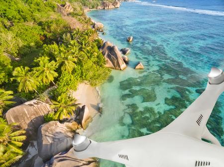 Drone flying above tropical beach on Seychelles
