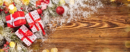 Christmas gift boxes placed on wooden planks. Copyspace for text Stock Photo