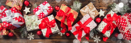 panoramatic: Christmas gift boxes placed on wooden planks in panoramatic composition Stock Photo