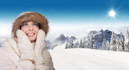 panoramatic: Beautiful winter portrait of young brunette woman in the winter snowy scenery Stock Photo