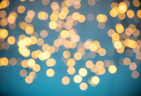 illuminated: Blurred Christmas abstract golden spot lights with soft blue background Stock Photo