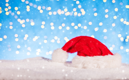 Christmas background with Santa cap, placed on pile of snow