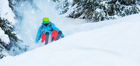 freerider: Freeze motion of freerider in deep powder snow, skiing in forest