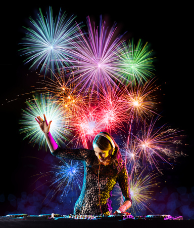 Young woman dj playing music, firework on backround. Celebration of New Year