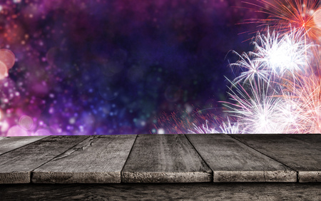 Abstract colored firework background with old wooden planks, ideal for product placement Stock Photo - 103226845