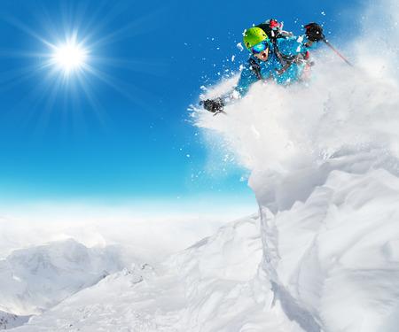 powder snow: Freeride skier ready to jump in freeze motion of snow powder. Stock Photo