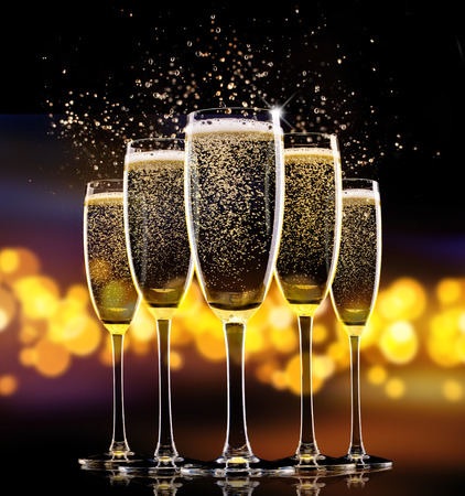 Group of glasses of champagne over blur spots lights background. Celebration concept Фото со стока