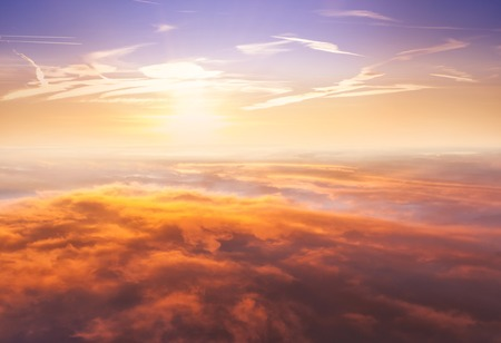 above the clouds: Beautiful sunset above clouds from airplane perspective. High resolution image