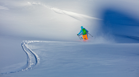 freerider: Freerider skier running downhill in fresh powder snow Stock Photo