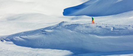 freerider: Freerider alpine skier walking in fresh powder snow. Wide composition Stock Photo