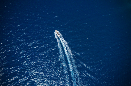 Aerial view of small boat flowing in sea, travel and vacation concept