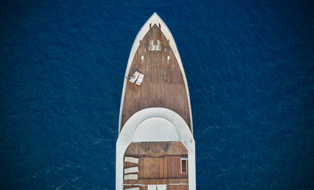 Aerial close-up view of big luxury yacht in sea, copyspace for text Imagens