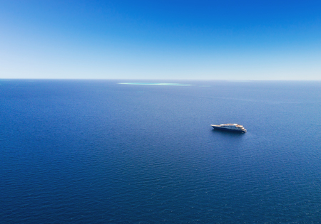 a big ship: Aerial view of big luxury yacht in sea, copyspace for text