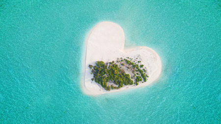 Beautiful small tropical island in heart shape, concept of love and tropical vacation