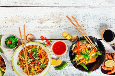 Asian food served on white wooden table, top view, space for text. Chinese and vietnamese cuisine set. Stock Photo