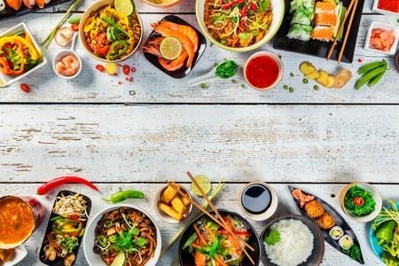 thailand view: Asian food served on white wooden table, top view, space for text. Chinese and vietnamese cuisine set. Stock Photo