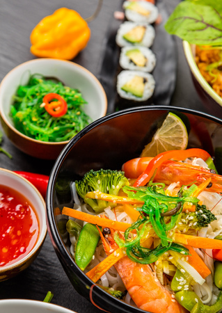 Asian food served on black stone. Chinese and vietnamese cuisine set.