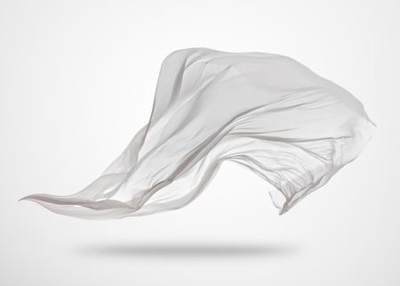 Smooth elegant transparent white cloth separated on gray background. Texture of flying fabric.