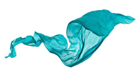 白い背景の上に滑らかなエレガントな青い透明な布が区切られます。飛んでファブリックのテクスチャです。