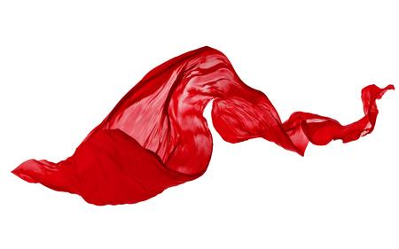 Gladde elegante rode transparante doek gescheiden op een witte achtergrond. Textuur van vliegende stof. Stockfoto