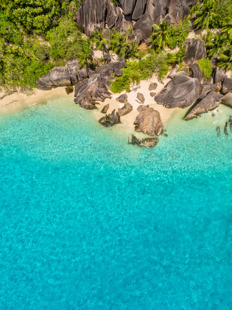 Aerial photo of beautiful paradise Seychelles tropical beach Anse Source D Argent at La Digue island. Summer vacation and travel concept Stock Photo