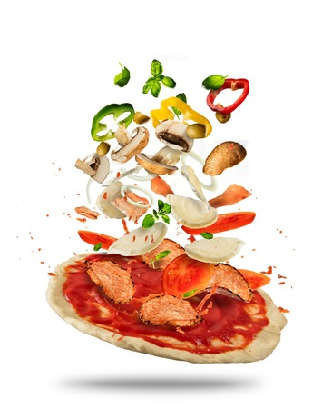 Concept of flying ingredients with pizza dough, isolated on white background. Food preparation, fresh meal ready for cooking