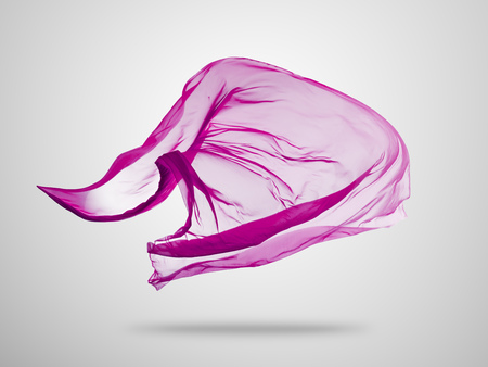 Smooth elegant pink transparent cloth separated on grey background. Texture of flying fabric.