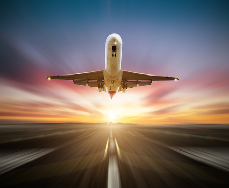 Passengers airplane taking-off the runway, blur motion effect as background. Concept of fast travel and transportation Stock Photo