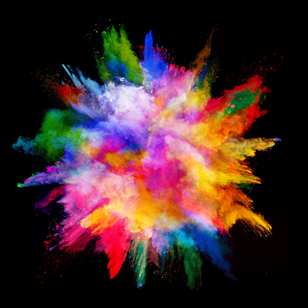 Explosion of colored powder, isolated on black background. Power and art concept, abstract blust of colors. Banco de Imagens