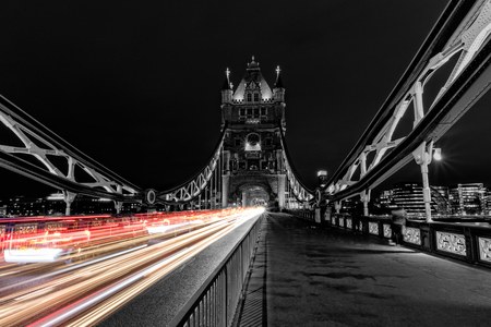 history building: Tower Bridge in London in black and white, UK at night with blur colored car lights. One of the most famous history building in England