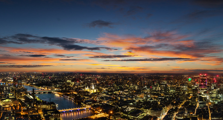 illuminated: Beautiful sunset over old town of city London with monumental St. Paul cathedral and bridges over river Thames, England, Europe.