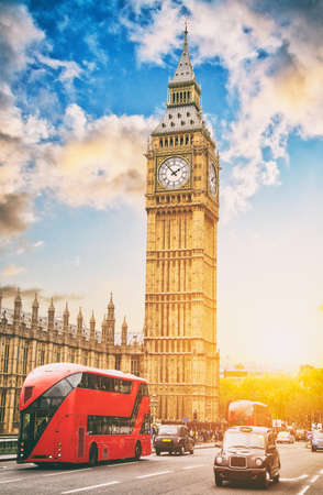 The Big Ben, the House of Parliament and the Westminster Bridge with typical double deckers and taxi cars, London, UK.