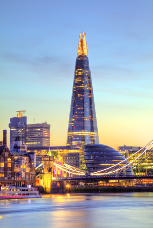 Beautiful sunset of modern part of city London, England, Europe. One of the leading centres of global finance. Stock Photo