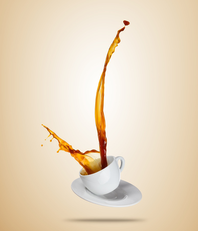 Porcelaine white cup with splashing coffee or tea liquid separated on brown background. Hot drink with splash, beverages and refreshment. Copyspace for text. Imagens - 77460988